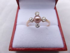 14 karat gold ring set with bolshevik cut diamonds and a pink pearl, Europe around 1920