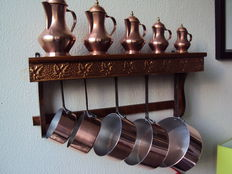 Wooden and copper shelf with copper pots and pans (tinned aluminium)