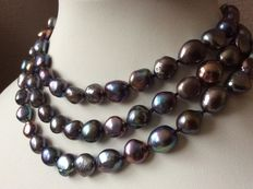 Necklace with natural, freshwater,  baroque, button pearls.