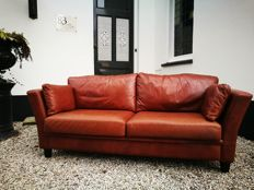 Designer unknown - three seater cowhide couch (hand made)