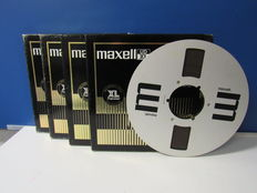 Four beautiful Maxell 26.5 metal reels.