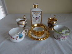 Seven pieces of antique porcelain – 4 separate bowls, 1 cup and saucer and 1 flask