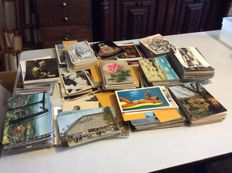 Postcards from different countries and themes +/-800 pieces new and sent mixed together