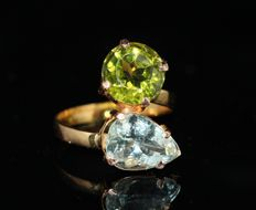 18 kt gold ring set with peridot and aquamarine