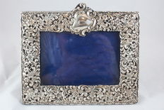 A silver Photo frame - 1924 - Decorated with Flowers. England.