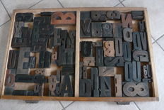 Old typecase tray from a typecase cabinet of a printing company with approximately 120 original  types (letters)
