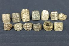 A group of 13 silver embossed rings  - China -  late 19th early 20th century