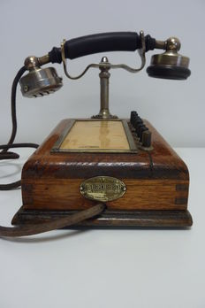 Antique wooden telephone with nickel horn from lawyers offices