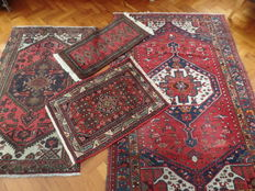Four hand-knotted carpets 202 x 138,  160 x 96,  94 x 46,  91 x 65