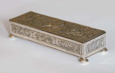 Silver box with decor of romantic couple in the middle and lovebirds on the edges.