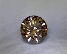 Brilliant round cut vivid brown diamond of 0.51 ct VVS2 IGL certified *** low reserve price ***
