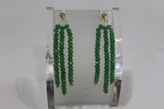 Ladies' gold earrings with 4 x 2 mm emeralds