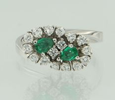 18k white gold ring set with 2 emeralds cut in drop shape and 16 brilliant cut diamond ***no reserve price***