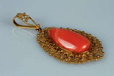 Gold pendant with pinkish coral droplet
