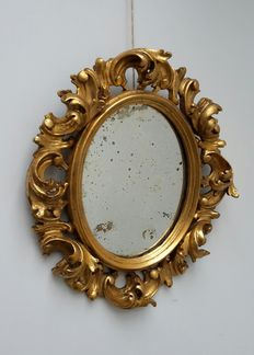A Baroque carved and gilt wood wall mirror - Italy - 19th century, possibly earlier