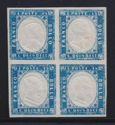 Kingdom of Italy, 1863 – Block of four 15 Cents blue stamps, with the stamps on the left having a double portrait