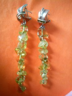 Silver earrings with naturally shaped faceted peridot