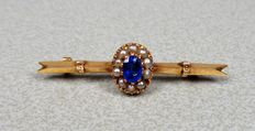 14k gold brooch with sapphire and pearls.