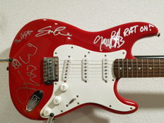 Squier Affinity Strat signed by The Boomtown Rats (Geldof, Roberts, Crowe, Briquette) with COA