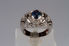 18 kt white gold ring, with oval sapphire and diamonds.