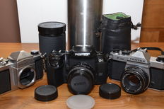 3 Pentax 35 mm SLR cameras, the Pentax Z-1, the K1000 and the body of the S1a.