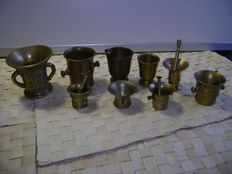 Collection 9 small copper mortars with pestle