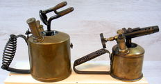 Two brass burners with iron handle