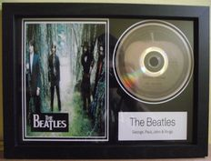 The Beatles, framed photo and  CD disc. 'Something' Apple label.