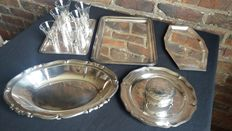 assorted silver and silver plated serving platters