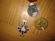 1 Cross of Honour of the German Mother/Silver 1. Medal Winter Battle 1941/42 1. Badge for Day of German Art
