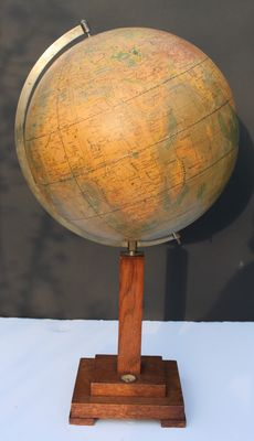 Globe on wooden foot with compass