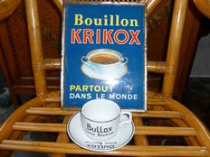Advertising sign, cup and saucer linked to broth. Period 1960.