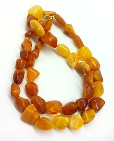 Amber necklace of egg yolk honey polished beads of Baltic amber, weight is 26,92 gr.