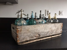 Nine glass spray bottles in wooden crate-ranging from 1900 to about 1960