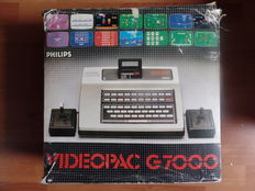 Boxed console VIDEOPAC G7000 + cables, with 2 joysticks and 7 boxed games