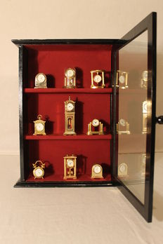 Nine gold plated miniature clocks with display case – Second half of the 20th century