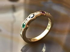 A ring with 8 brilliants, ruby, sapphire and emeralds, 18 kt gold