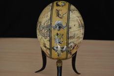 Ostrich egg decorated with a map of the world and the Big Five