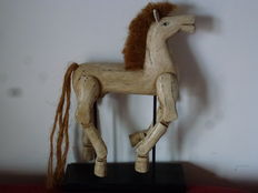 Gorgeous wooden horse on a wooden base with harmonious movement of the limbs in the various positions of race - the sorghum horse hair and tail make it a unique piece - interesting project of a work created by a skilful craftsman