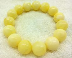 Baltic amber bracelet with round white- yellow butterscotch beads, highly polished, 32.33 g