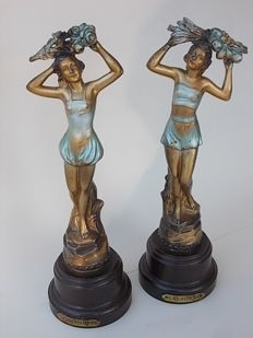 Pair of coloured antimony statues with base, representing spring and autumn, British, late 19th century