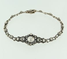 Gold and silver bracelet, set with different rose cut diamonds.