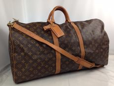Louis Vuitton - Keepall Bandoulière 60 - Travel bag with shoulder strap, padlock with key, name tag and handle holder