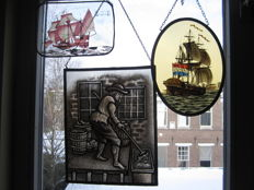 "Two beautiful stained glass in lead suncatchers ""De Arbeider"" and ""De Schip"" and a cold painted stained glass ""The GOLDEN HIND"" - 20th century"