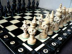 Chess made of carved wood, case made of silkscreened wood