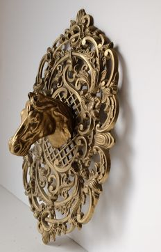 Copper wall ornament with horse head.