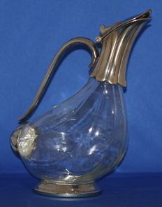 Duckbill decanter with silvered ornaments.