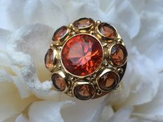 Gold ring with natural orange sapphire.