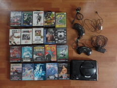 Sega Mega Drive console + cables, with 2 joysticks and 20 boxed games