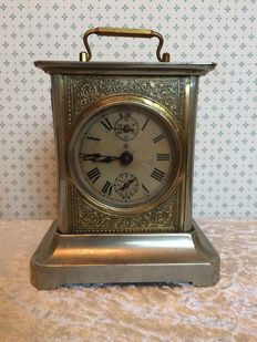 Metal nickle-plated travelling alarm clock with German carillon - early 20th century.